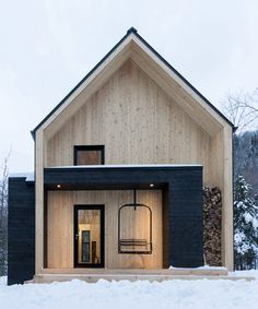 cargo architecture clads villa boreale in quebec with black metal and white cedar