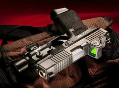 Glock with SureFire and Trijicon RMR. Modifications done by ATEi Home Defense, Self Defense, Glock Sights, Glock Mods, Camouflage, Hand Cannon, Custom Glock, Battle Rifle, Cool Guns