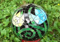 This a beautiful stained glass mosaic gazing ball made from a recycled 16 lb bowling ball and scrap stained glass. This is my own tulip design a Mosaic Pots, Mosaic Garden, Mosaic Glass, Glass Garden Art, Glass Art, Delphi Glass, Mosaic Crafts, Stained Glass Projects, Artist Gallery