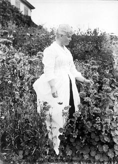 Celia Thaxter in her garden. Celia was the author of An Island Garden and friend of famed impressionist, Childe Hassam