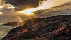 Hawaii Sunset over Lava - Sun breaking behind the clouds . Photography by Eric Schaer
