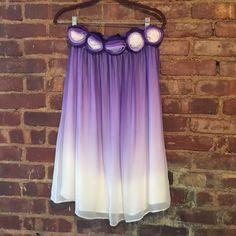"""Alice + Olivia Lavender Strapless Dress Light as air, ethereal boho dream skirt! 100% silk in the most gorgeous lavender ombré. Five charming rosettes at the waist. One small pull at the back. Perfect for weddings or garden parties with sparkly heels and a floral crown. Originally worn as a strapless dress. Approx 14"""" across and 27"""" long. Alice + Olivia Skirts Midi"""