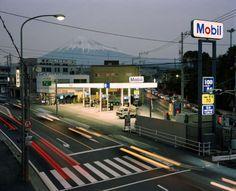 "20aliens: "" JAPAN. Fuji City. Mobil filling station from footbridge. 1999 Chris Steele-Perkins """
