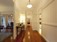 love the wainscoting and the transom detail