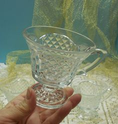 Clear Pressed Glass Footed Cups With Diamond And Scallop Pattern. $15.00, via Etsy.