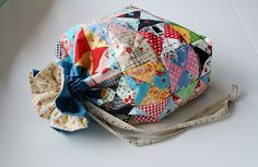 Darling scraptastic quilt-pieced drawstring bag! What a fun way to use some leftover quilt blocks too! tutorial here: http://www.incolororder.com/2011/10/lined-drawstring-bag-tutorial.html