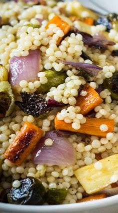 "Warm Israeli Couscous and Roasted Vegetable Salad - the recipe for fennel roasted fall vegetables is on my board ""sides"". We didn't use the dressing. Scraped the juices from roasting the vegetables into the bowl with the couscous."