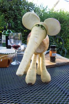 Trumpet (and Squeak) - Aimee's entry to the village vegetable sculpture competition. Parsnips, swede, turnip, chives and cloves.