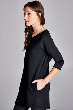 Our Gabie Tunic is absolute perfection! We love the loose 3/4 sleeves and pockets. Style this with your favorite pair of leggins or skinny jeans. 95% Polyester, 5% Spandex Made in the USA Sizing Small 2-4 Medium 6-8 Large 10-12