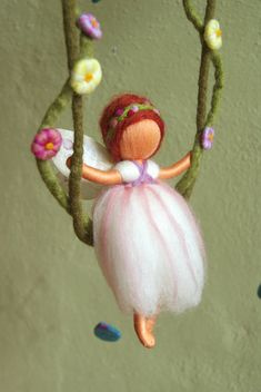Here you can see a very nice mobile, with a fairy on a swing. The leaves falling down from the twig, and some butterflies keep her company. This mobile has a diameter of approx. 14. The little fairy is about 4.5 high and each of the three butterflies about 2.7. The fairy, the swing,