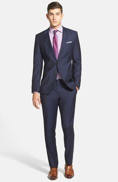 Finely textured wool shapes a handsome, professional suit that features a two-button, notch-lapel jacket, subtle pickstitching and flat-front trousers.