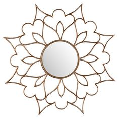 Sunburst-inspired wall mirror with an openwork floral frame.   Product: Wall mirror  Construction Material: E...