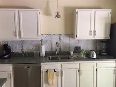 Shiplap peel and stick wallpaper used as a kitchen backsplash ...