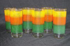 Orange, yellow and green tumblers.