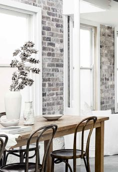 An all-white industrial-style home with minimalist charm in Sydney Brick Interior, Industrial Interior Design, White Interior Design, Industrial Interiors, White Industrial, Industrial Style, Antique White Usa, Timber Table, Storey Homes