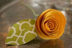 Rolled Paper Flowers: Looks simple and easy to make. Good use for paper scraps/recycled greeting cards or other paper.