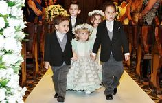 The little bridesmaids, Carolina Tomasi and Leticia Filgueiras were really cute with gypsophilla crowns on the head. The ring bearers, Murilo and Leonardo Tomasi, and Lucas Filgueiras wore a look just like the groom's. Wedding of Nicole Domakoski and Miguel Bochnia Machado