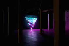 """The artist Flynn Talbot has created a lighting installation called """"Primary"""" that has been exhibited at PSAS, in Perth, in Australia. This artist explores the 3 primary colors and triangular shapes through 3 different LED lights' sources. Discover the installation through John Madden's pictures."""