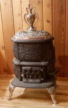 """Cast iron and nickel wood burning stove Ivy Michigan No 21 D made by the Michigan Stove Co. (Detroit Chicago), Circa 1890. Dimensions 46"""" tall x 24"""" wide x 17"""" depth. Stove is located in Elkhorn, WI - for local pickup or can be delivered within an hour drive of Lake Geneva, WI. $1699"""