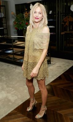 Sienna Miller in a gold lace Burberry mini dress