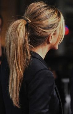 a favorite hair style. And, great tip I just read on Bella mumma....there are actually two pony tails in this photo stacked on top of one another and tightly wound for pony volume and root volume. great idea!