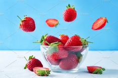 Fresh strawberries in a glass bowl by Natasha on @creativemarket
