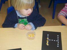 Paper, glue and corn create great fine motor skills fun!