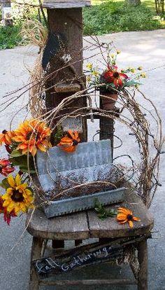 Sweet Autumn...grapevine wreath & chicken feeder on the prim chair.