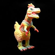 The Garuda edition of #poultryrex painted by @candiebolton and designed by @ronenglishart goes on sale today at 12 pm pacific. This beauty is painted with a myrid of pastel colors on yellow base vinyl. Very limited so dont miss out! @team_popaganda #ronenglish #teampopaganda #candiebolton #tyranosaurusrex #dinosaur #chicken #sofubi #sofvi