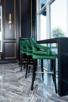 With an intricate brass chandelier, emerald armchairs and a marbled floor, this macaron bakery from Contour Interior Design shines with Art Deco glamour. A crescent-shaped bar showcases the colorful macarons available to customers.
