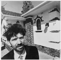 Howard Arkley in front of one of the houses he painted in his House and Homes series, 1988. Supplied: Martin Kantor