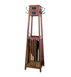 On the interwebs I found this unattributed photo shot in a secondhand store. It's an unusual piece of furniture for sure: A freestanding Mission-style coatrack with two drawers for storage and an umbrella corral. I've never seen a piece that incorporated all of these elements. Whether you think it's ugly
