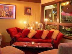 Charming In This Warm Living Room, A Vibrant Red Sofa Is Adorned With Red And Yellow Part 28