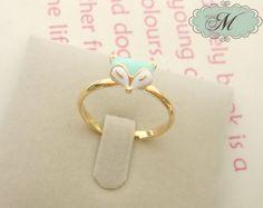 £8 - i really like this!  Tiffany Blue Fox Ring. $12.00, via Etsy.
