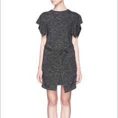 "Isabel Marant Etoile Tie Waist Mini Dress Isabel Marant Étoile Anthracite marled slub jersey short-sleeve Wad dress styled at front with asymmetric wrap panels. SOLD OUT everywhere. Size 40 French equivalent to a us 6  Relaxed fit, banded jewel neck 33"" from shoulder to hem (approximately) Slips on, ties at waist Unlined Available in Anthracite 50% polyamide, 30% linen, 20% virgin wool Dry clean Imported Isabel Marant Dresses Mini"