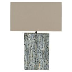 An elegant addition to your living room, home office, or master suite, this chic luminary brims with coastal appeal and stylish sophistication.   ...