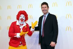"Steve Easterbrook, CEO McDonald's, poses with Ronald McDonald. Easterbrook just got a 368% bonus for coming up with the idea of ""all day breakfasts"" at McDonald's. Meanwhile, McDonald's is against raising the minimum wage."