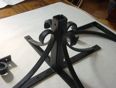 hand forged shelf brackets, but they could be something else.