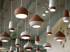 A clay famous for it& brownish-orange color, terracotta has been used throughout history for sculpture, pottery, bricks, and lately (jumping ahead several centuries) pendant lighting. Led Lighting Home, Suspended Lighting, Pendant Lighting, Pendant Lamps, Ceramic Light, Ceramic Pendant, Ceramic Lamps, Raku Pottery, Light Fittings