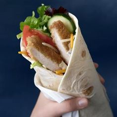 McDonalds adds new chicken McWrap to menu (Photo: McDonald's handout / AP) - Food ~ can't live without it :) - Fast Food Healthy Sandwiches, Wrap Sandwiches, Puerto Rico, Crispy Chicken Wraps, Sweet Chili Chicken, Chicken Bacon, Grilled Chicken, Mcdonalds Coupons, Mcdonalds Chicken