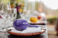 purple, yellow and orange maracas for wedding reception in Mexico.