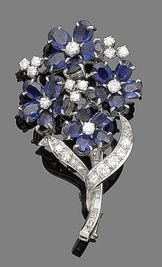 A sapphire and diamond flower brooch, by Cartier, circa 1940. The stem set with baguette-cut diamonds, to four flowerheads, the petals set with oval-cut sapphires, with brilliant-cut diamond stamen and leaves, diamonds approx. 1.10cts total, signed Cartier, numbered, length 5.3cm, maker's case