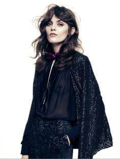 Black sheer blouse, sequin cape and black on black velvet print pants - an insanely cool outfit.