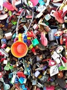 """N'Seoul Tower's """"Locks of Love"""" hang on the wall of a terrace attached to the tower. Couples hang their locks of love before throwing away the key, in the hope of eternal love."""