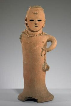 Size: 22 3/8 x 9 3/4 x 8 1/2 in. (56.83 x 24.77 x 21.59 cm) Style: 6th century, Kofun Physical Description: standing female figure with proper left arm bent, hand at side; flat mask like face, adorned by earrings and necklace; ridged dress extends to floor covering legs and feet Credit: Collection Minneapolis Institute of Arts; The Christina N. and Swan J. Turnblad Memorial Fund