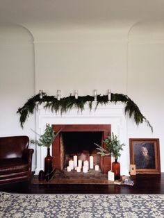 pretty candles in a fireplace #fireplace #christmasdecor