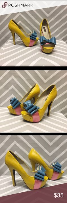Amazing Mojo Moxy Pipa Platform Heels Absolutely charming stiletto heels they are yellow leather and heels are 5.75 inches high the size is 9 1/2 women's they have blue bow and a pink ribbon. Small amount of scuffing, but in otherwise good used condition! *price firm* Mojo Moxy Shoes Heels