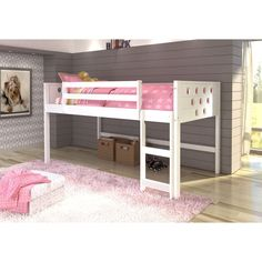 Bedtime and playtime are one and the same with this kid's loft bed. The twin-size bed, made of sturdy pine wood, is lofted to create a special play area underneath. Constructed from solid wood, this furniture is sure to offer long lasting comfort.