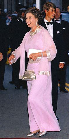 At her mother's 80th birthday celebration in London, Elizabeth shined in a subtle way – wearing a pale violet gown with hints of shimmering sequin beading along the cuffs and collar, plus her favorite silver shoes and handbag.