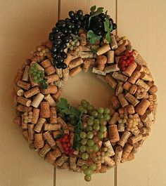 Not sure if I like the plastic grapes...but I am definately loving the wreath it self.